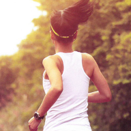 A woman jogging along a country road