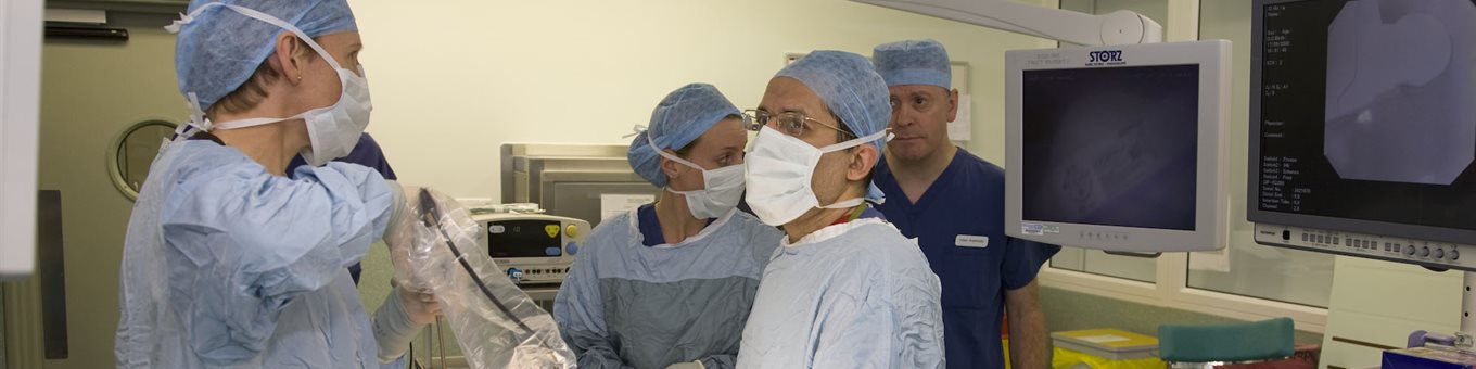 doctors in a surgical setting wearing masks and scrubs