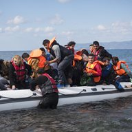 Refugees packed in a dinghy