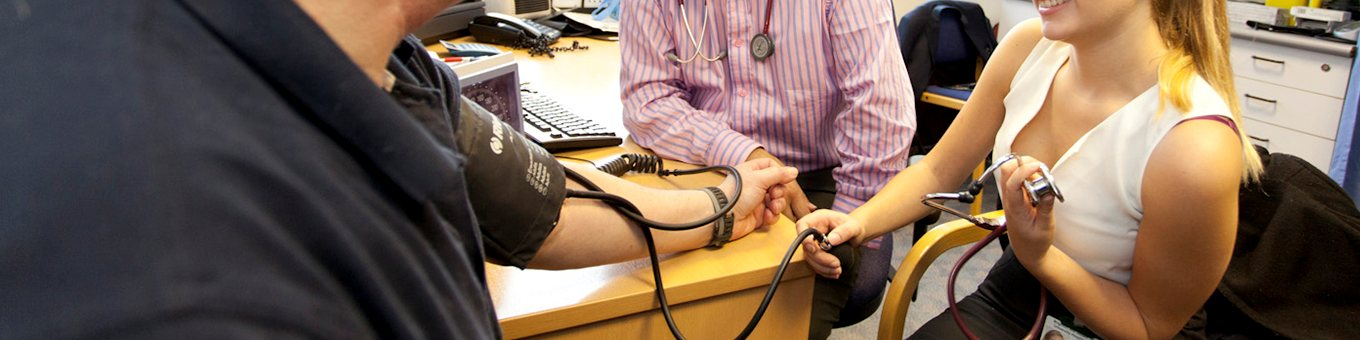 Student taking a patients blood pressure