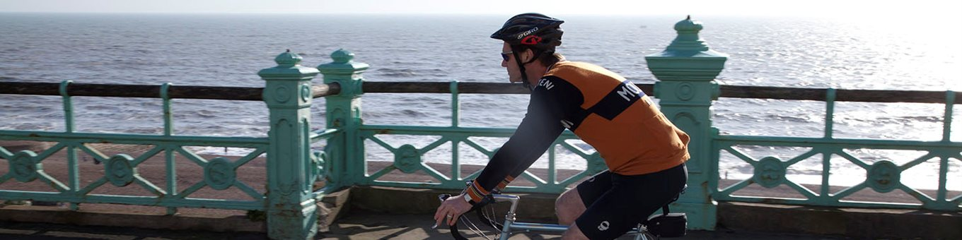 Cyclist on seafront