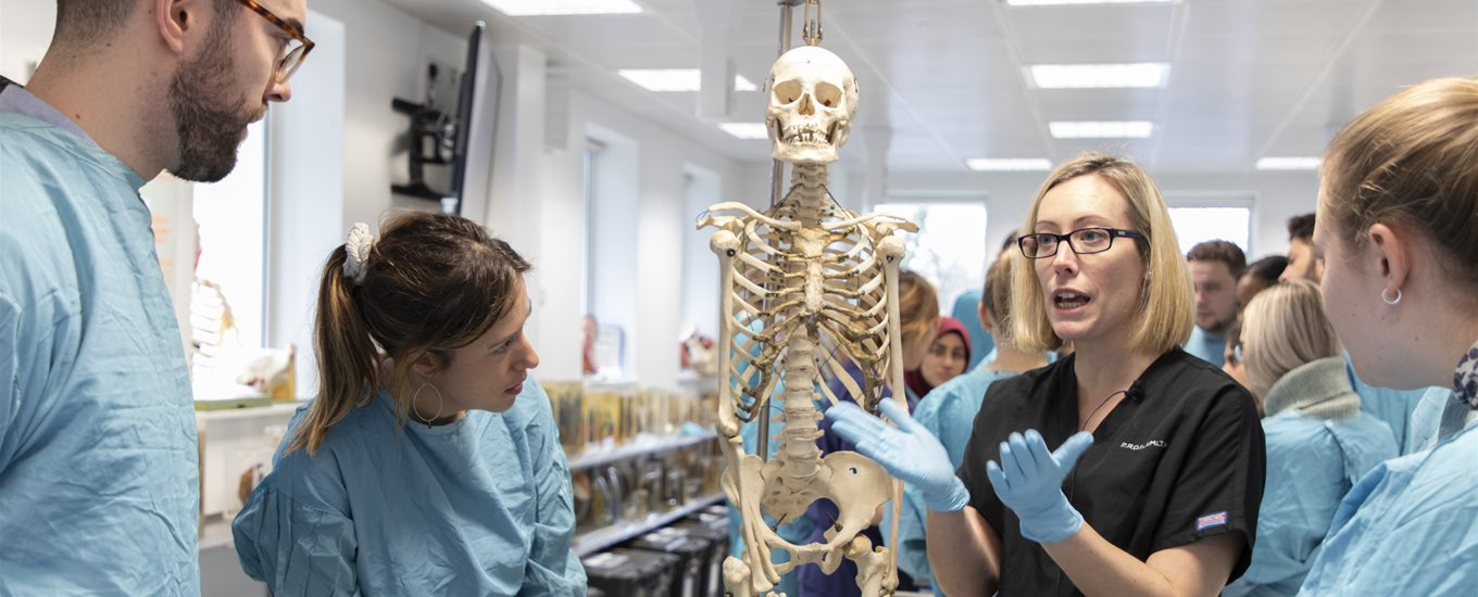 Prof Claire Smith talking to students in anatomy lab