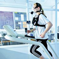 Patient runs on a treadmill as part of a physical exercise examination
