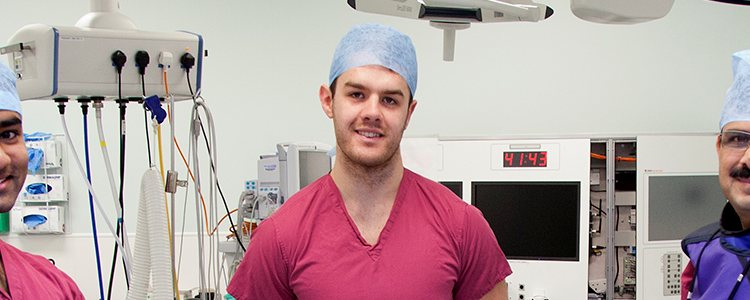 matthew cadd poses in operating theatre