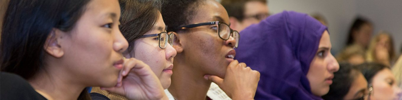 students listening to lecturer closeup
